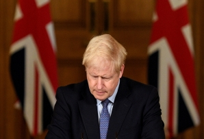 Britain's Prime Minister Boris Johnson reacts during a virtual press conference inside 10 Downing Street in central London on October 20, 2020. (AFP)