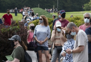(FILES) In this file photo taken on September 18, 2020, voters wait in line to cast their ballot at an early voting location in Fairfax, Virginia. More than 50 million Americans have voted early in the White House race pitting President Donald Trump against Democrat Joe Biden, the US Elections Project, run by the University of Florida, said on October 23, 2020.