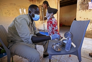 A medic disinfects his tools inside a medical facility for Ethiopian refugee who fled fighting in Tigray province at the Um Raquba camp in Sudan's eastern Gedaref province, on November 21, 2020.