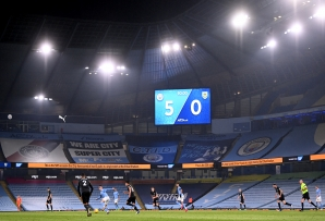 The score board shows 5-0 in the final minutes during the Premier League match at the Etihad Stadium, Manchester.