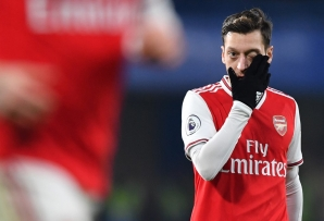 FILE: Arsenal's German midfielder Mesut Ozil reacts during the English Premier League football match between Chelsea and Arsenal at Stamford Bridge in London on January 21, 2020.