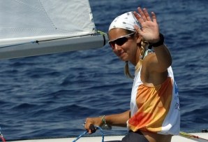 In this file photo taken on August 19, 2004 Greek skipper Sofia Bekatorou (R) waves as she, and her teammate, cross the finish line, during the Women's Double-handed Dinghy-470 race nine, at the 2004 Olympic Games in Athens.