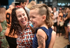 A child sports a mullet haircut at Mulletfest 2018 in the town of Kurri Kurri, Australia in 2018