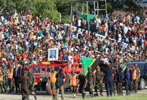 Tens of thousands of Tanzanians turned out to pay their respects to the late president as his coffin was transported to major cities