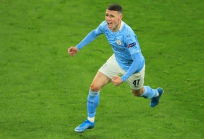 Phil Foden celebrates scoring for Manchester City in their Champions League quarter-final against Borussia Dortmund