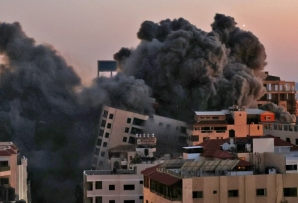 An Israeli air strike destroyed a 12-storey building in Gaza on Tuesday, and Hamas militants responded with a barrage of rockets towards Tel Aviv