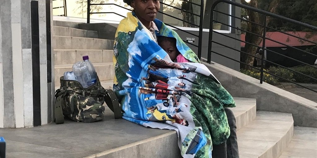 Mother, child camp outside Nigerian consulate for free ride home