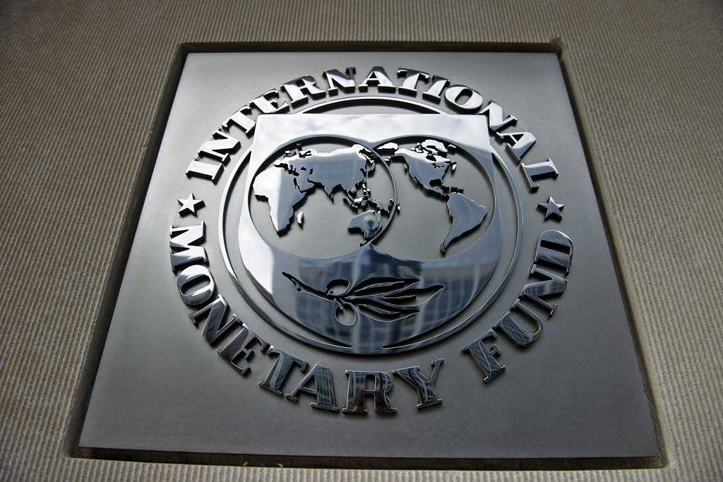 File: Last month, the IMF lowered its global economic growth forecast for this year from 3.7 percent to 3.5 percent.